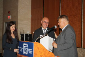 Toronto Councillor Jim Karygiannis presents Mr. Ozsoy with a speacial scroll